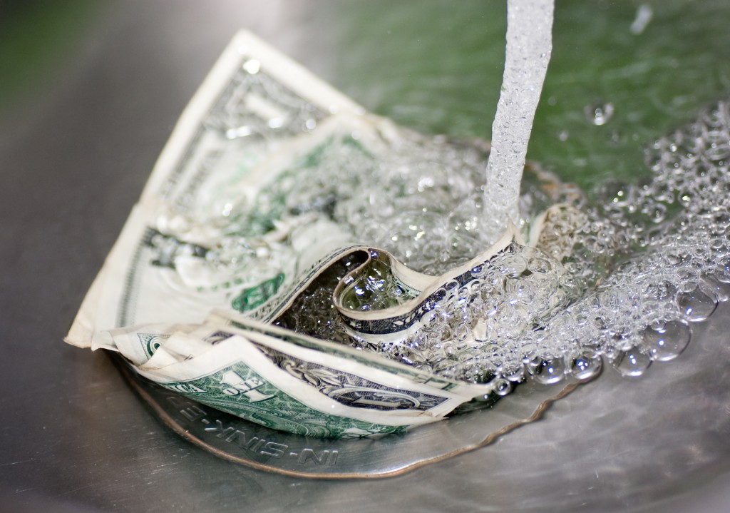 money-down-the-drain-dollar